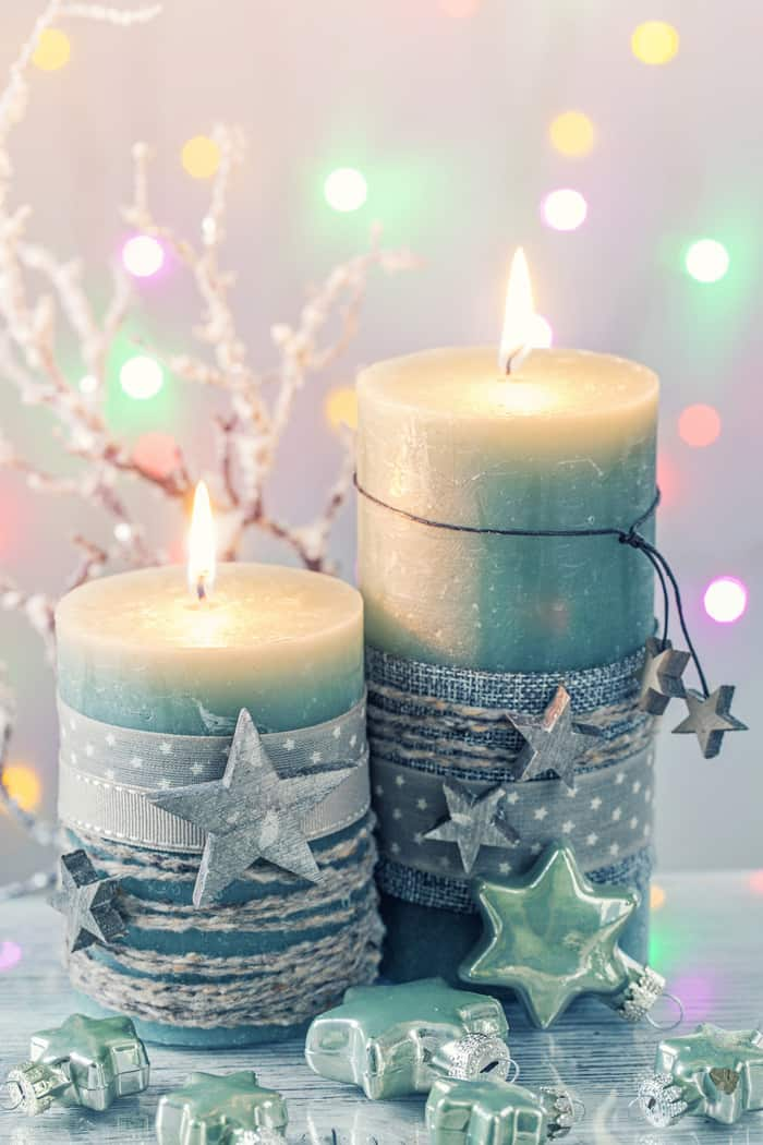 Green Candle Meaning - Two Candles Wrapped Stars