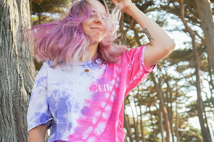 Aquarius Personality Traits - woman wearing tie-dye with purple hair