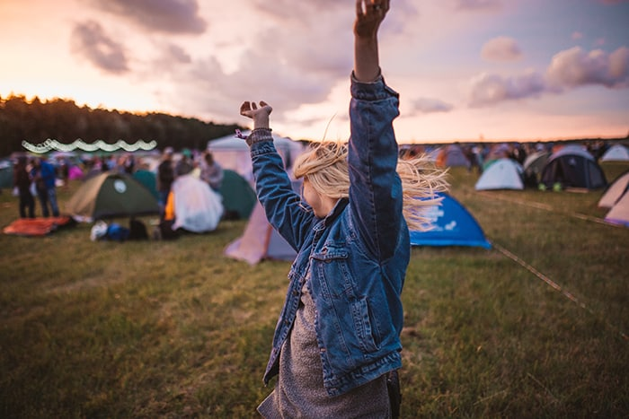 Aquarius Personality Traits - happy woman at festival
