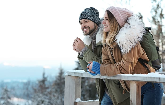 Capricorn Compatibility - Couple Hiking In Snow