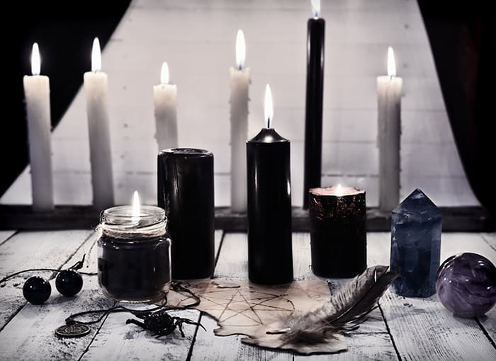 Black Candle Meaning - black and white candles on altar