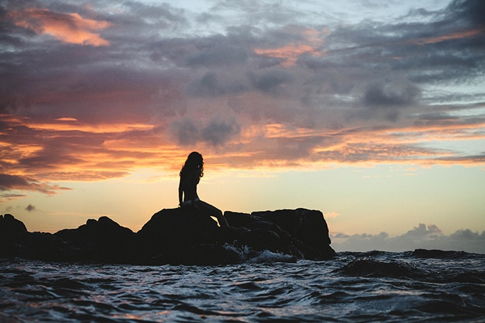 Pisces Traits - Mermaid on Rock