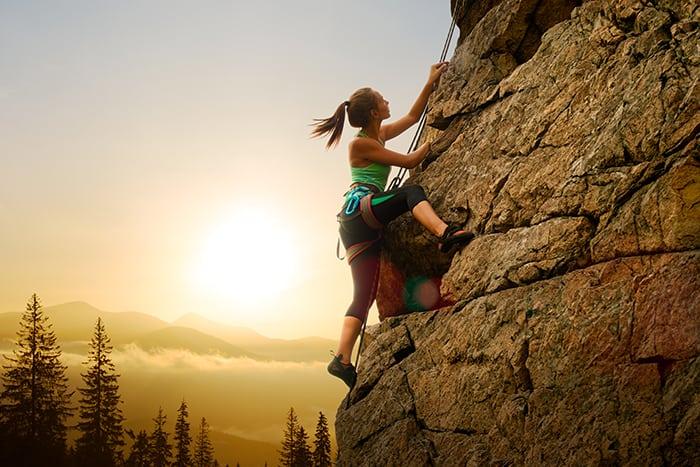 Aries Personality Traits - Woman Rock Climbing