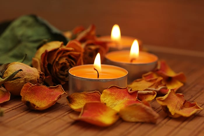 Orange Candle Meaning - Fall Leaves on Table