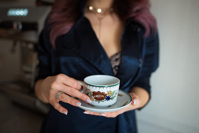 Signs You're Dating a Witch - woman holding teacup