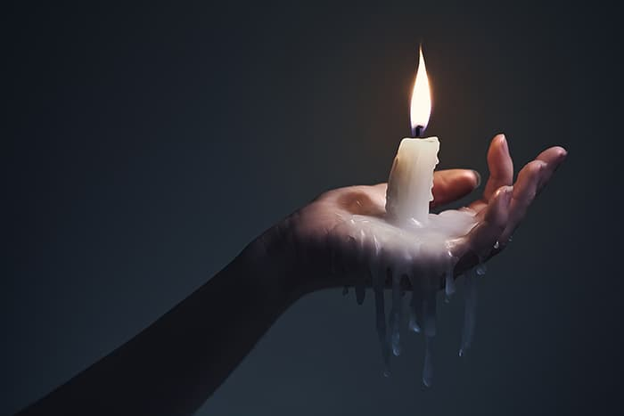 Candle Signs and Flame Meanings - Woman Holding Candle